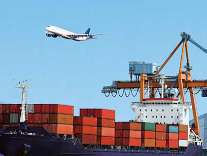 Airplane flying over cargo ship